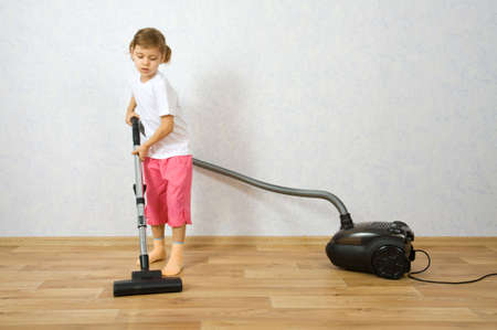 vac: Little girl cleaning floor with vacuum cleaner