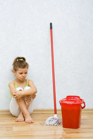 revulsion: Little girl cleaning the floor in the room