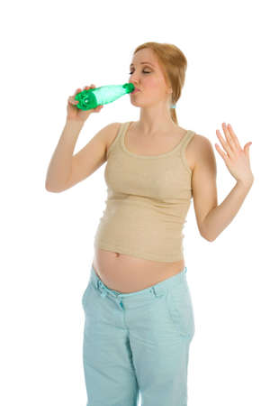 Pregnant caucasian woman drink water isolated on white photo