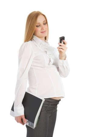 Pregnant caucasian businesswoman on a white background photo