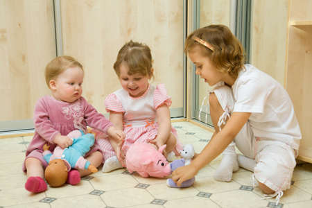 Little girls playing together in home room photo