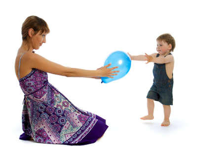 Young caucasian woman playing with boy photo