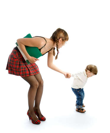 Young woman with a folder holding the hand of small child photo