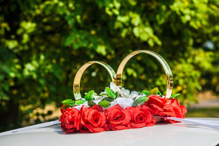 big decorate wedding rings on a roof of the car Stok Fotoğraf - 34241158