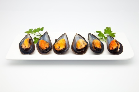 cooked mussels prepared to consume Stock Photo