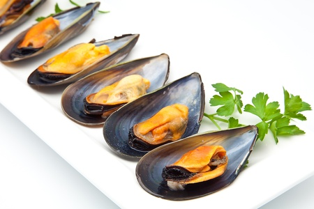 consume: cooked mussels prepared to consume Stock Photo
