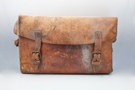 widely: widely used old leather suitcase