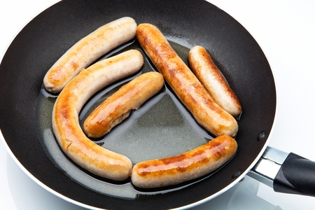 chorizos: sausages fried in a skillet