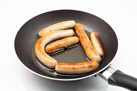sausages cooked in a frying pan  photo