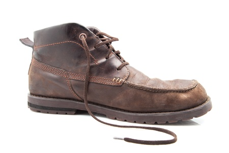 buttonhole: leather footwear used and worn out