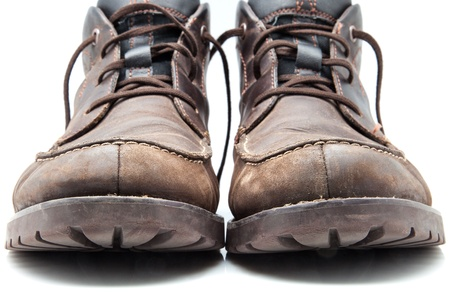 wornout: battered and worn-out leather boots