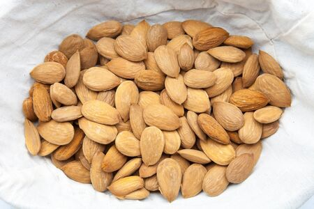 forefront: almonds peeled to eat of snack