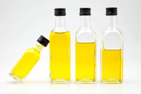 olive oil bottles on white fund photo