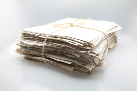 papers piled up on a white fund Stock Photo - 15789460