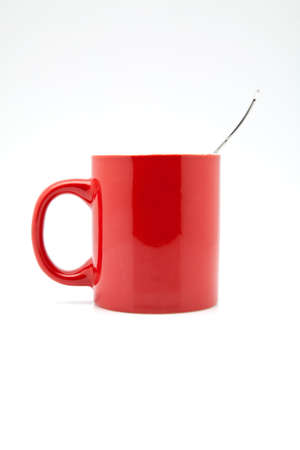 caffeine molecule: red cup of coffee on white fund