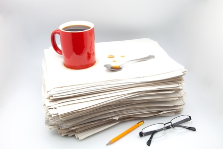 heap of role: documents, cup of coffee and glasses on white fund
