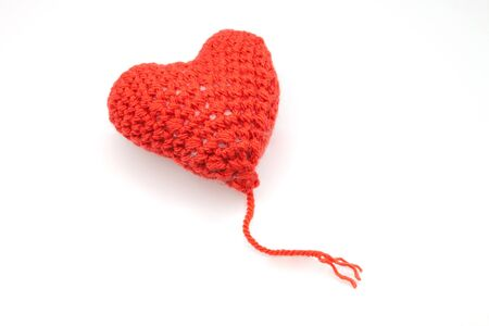 Red heart shape symbol made from wool isolated on white background Stock Photo - 16401100