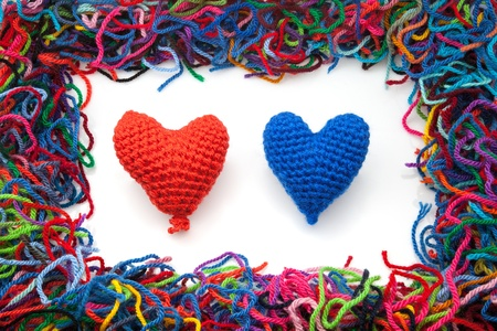 woven woolen hearts on a white fund Stock Photo - 16566908