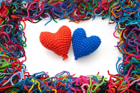 entanglement: woolen picture with colors hearts Stock Photo
