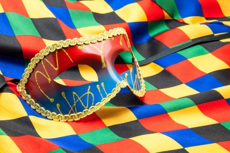 performace: carnival mask on buffoons disguise