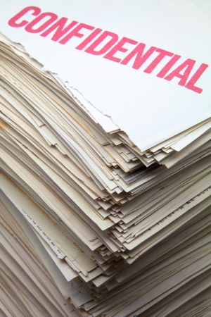 stack of documents: battery of confidential filed documents