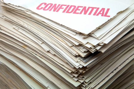 confidential: heap of confidential documents of role Stock Photo