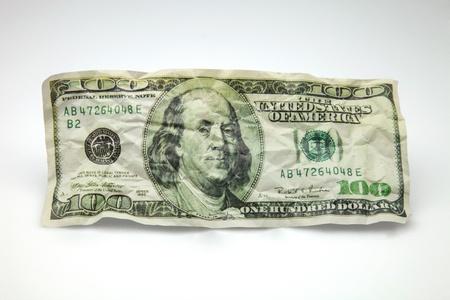 wrinkled and battered ticket for hundred dollars