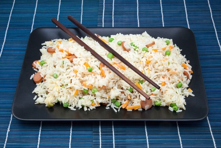 salver of rice fried with vegetables photo