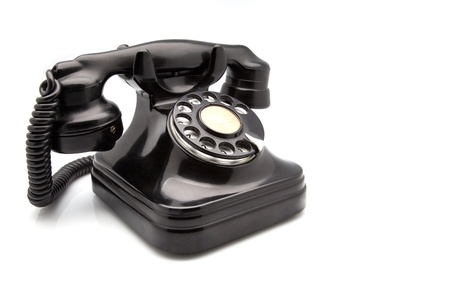 rotary dial telephone: black retro telephone made of Bakelite Stock Photo