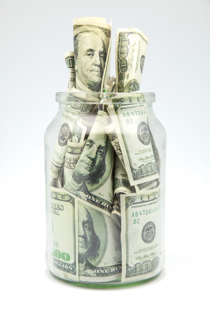 dollars bank notes in a glass jar photo