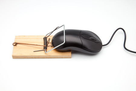Back computer mouse and mousetrap isolated on white background.