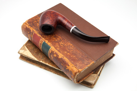 histories: tobacco pipe on ancient books Stock Photo