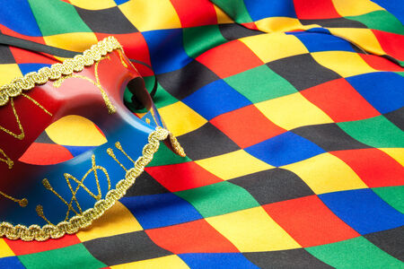mask and cloth of harlequin for a disguise Stock Photo