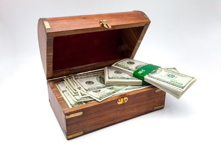 treasure trove: treasure trove full of banknotes of one hundred dollars Stock Photo