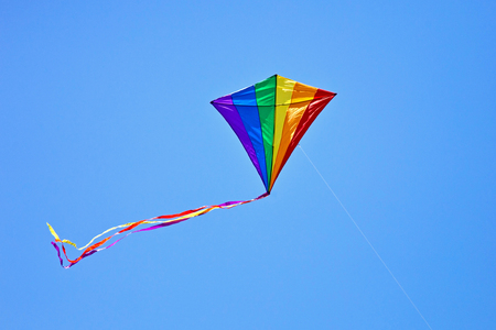 kite flying in the blue sky photo