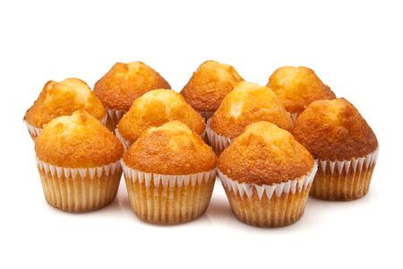 cornbread: ten cupcakes gold on a white background