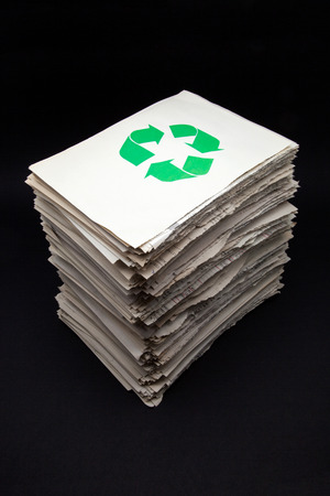 stack of documents for recycling on a black background photo
