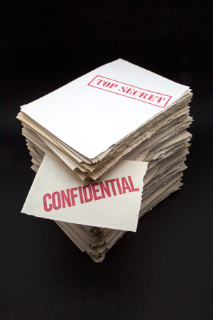 lot of confidential papers on black background photo