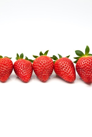 ripe strawberries on white background photo