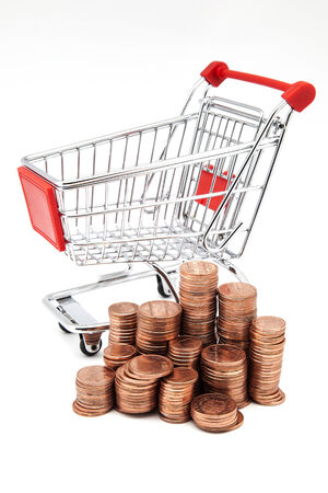 rebates: shopping cart with coins on a white background