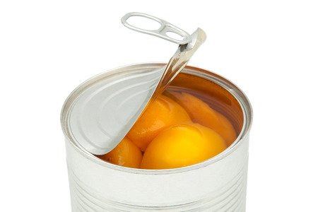 canned fruit: Tin of peaches on a white background