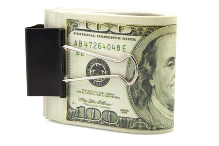 commercial activity: banknotes of one hundred dollars subjects with a clip Stock Photo