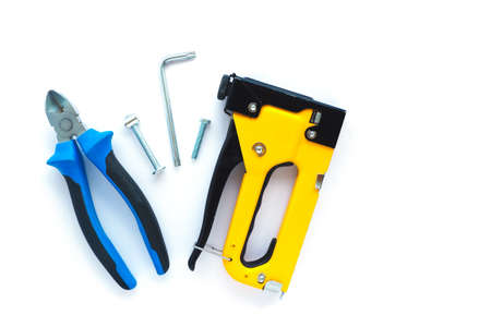 fasteners and repair tools on a white background. flat layout, top view. Space for text.