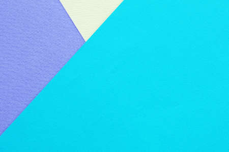 Abstract background and texture. Three sheets of multi-colored lilac, turquoise and light yellow paper.
