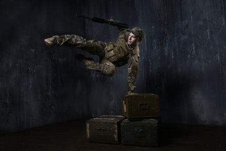 anti terrorist: Training soldier. Soldier jumping over boxes of ammunition.Around the world those guys keep us safe Stock Photo
