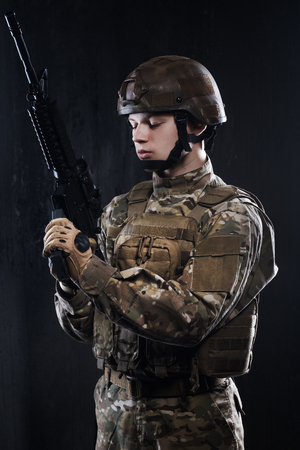 reloading: Man reloading a rifle. Ammunition Soldier. Modern soldier with rifle