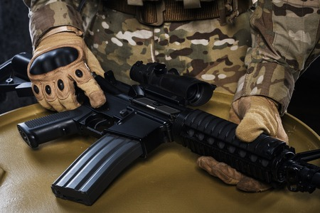 defense facilities: Airsoft Automatic close up. New technology. Military