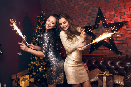 warmest: Two girls in a beautiful dress dancing and smiling with a sparkle. Happy Hew 2017 year! Warmest Wishes For Christmas!