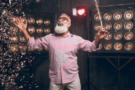 Happy bearded man have a fun with sparkle. Who like to have presents and holly jolly x mas Festive seasonal occasion. Happy modern Santa dancing in gold confetti on New Year party.
