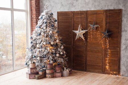Christmas and New Year decorated interior room with presents and New year tree Banco de Imagens - 90611723